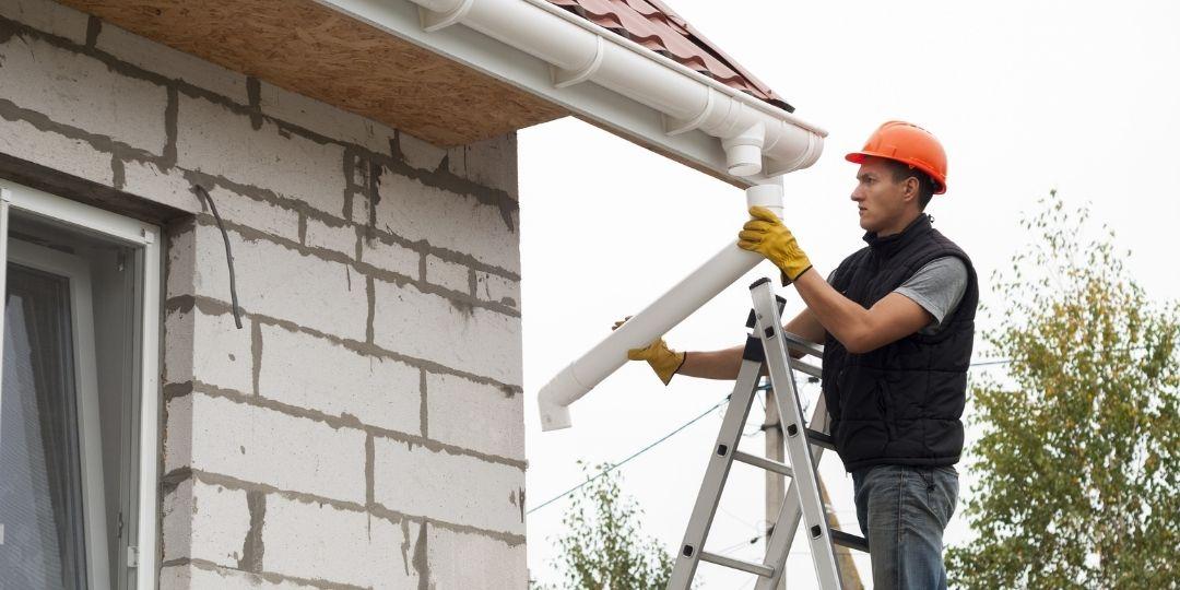 Worker installing new gutter in Stockton