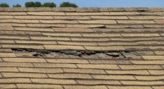 Damaged roof due to roof leak, in need of repair.