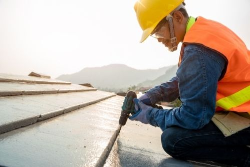 Roofer installing roof in Stockton